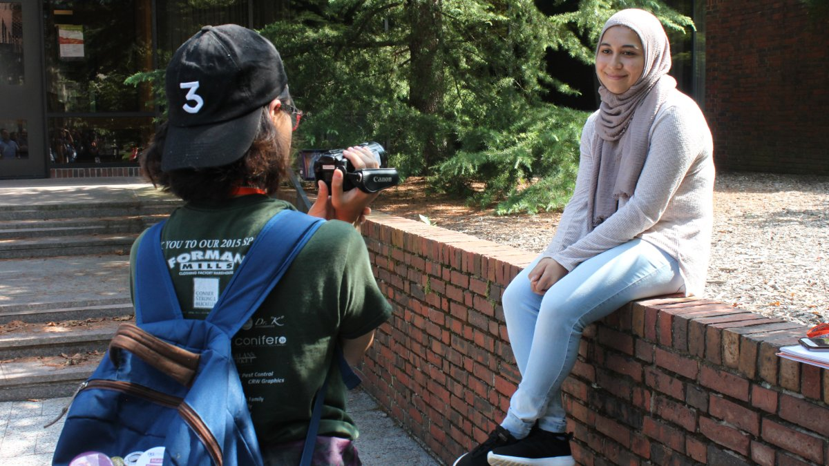 A student films another student for an interview